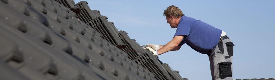 dakdekker op het dak
